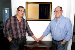 Collectors: Melvin Thompson and Harvey Bouchard, with Robert Houle painting, 2012.