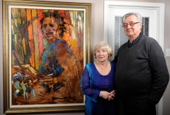 Collectors: Rudy and Gloria Bies with Arthur Shilling painting, 2012.
